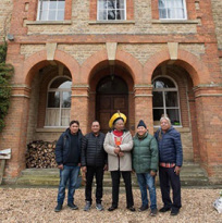 Four indigenous activists in front of a brick building in Oxford