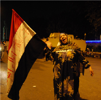 Woman waving a flag during demonstrations in Egypt
